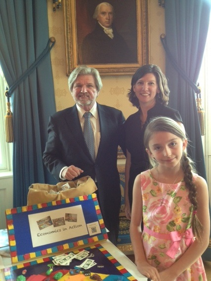 The impressive young student with her homemade arts and economy game, which I stopped by to play.