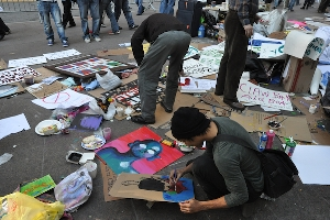 The art of signs used at #OWS (photo from hyperallergic.com)
