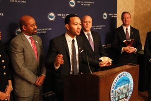 John Legend speaks while receiving a Citizen Artist Award from The United States Conference of Mayors and Americans for the Arts. Also picture are Philadelphia Mayor Micheal Nutter (left), New Orleans Mayor Mitch Landrieu, and Maryland Gov. Martin O'Malley.