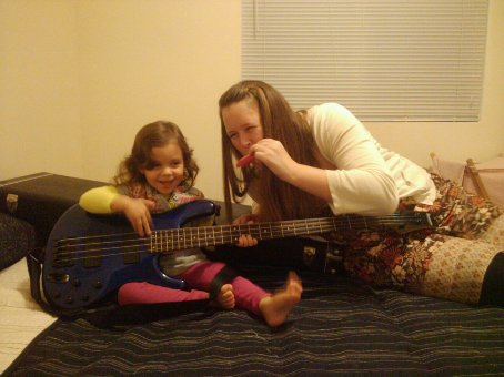 Sofia and mom during one of our jam sessions - no discussion of proper notes or finger patterns, just exploring the cause and effect of touching the string and making sound.
