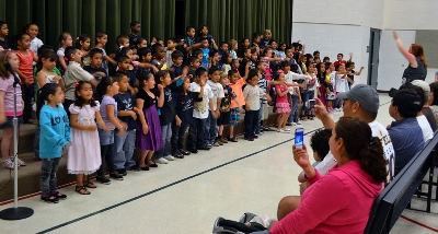 Students sing songs from their Reading in Motion program during an end-of-the-year performance for parents and the community.