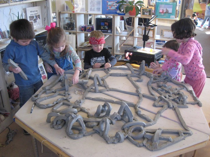 Students study the concept of lines in clay.