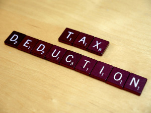 Tax Deduction spelled out in scrabble letters