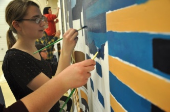 "ECTS students painting ""Setting the Stage for Erie's Future."" (Courtesy Danielle Wilber)"