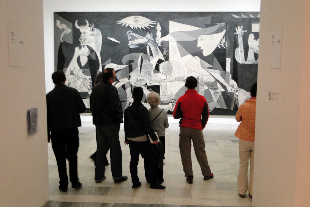 "Visitors view Picasso's ""Guernica,"" Museo Reina Sofia, Madrid. Photo by Adam Jones on Flickr."
