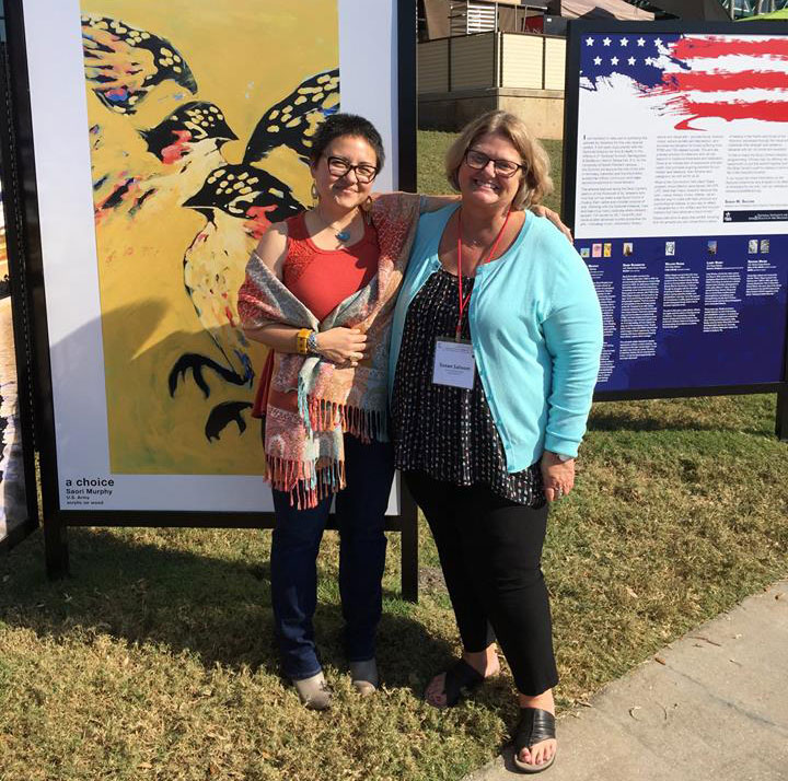 Artist Saori Murphy and Curator Susan Saloom at the Veterans Art Exhibit at the Straz Center for the Performing Arts in Tampa, FL.