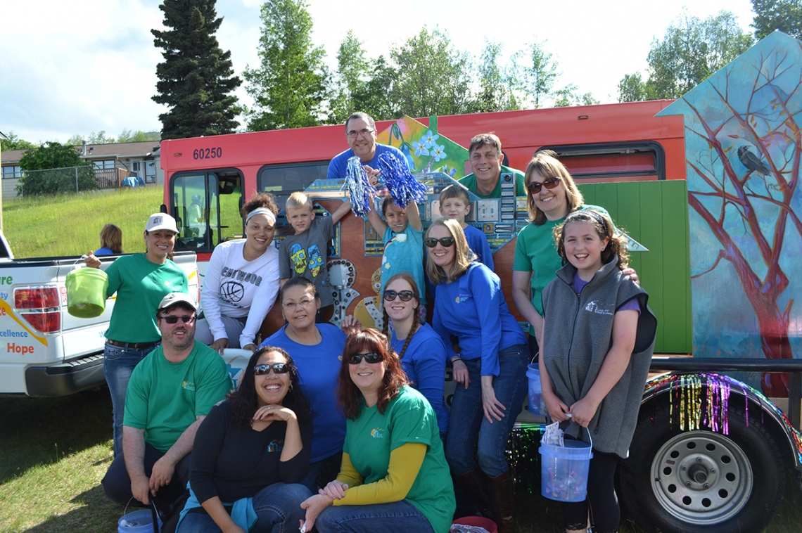 Cook Inlet Housing Authority staff and family members at the Bear Paw Festival.  Local artists collaborated on a float to draw attention to CIHA's #housingmatters campaign. Photo: ArtPlace America website.