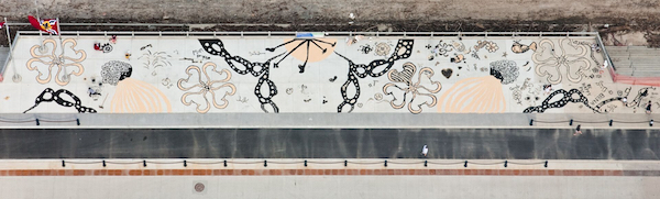 """Seed the Change"" by Jessica Witte. 400-foot-long drawing with the public (middle 120 foot section). Sunflower, safflower and millet seed. Arch riverfront, St. Louis, 2016."
