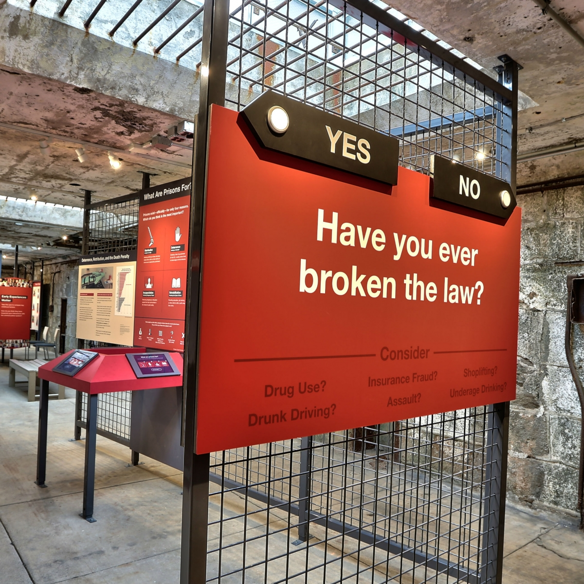 Prisons Today invites visitors to contemplate their relationship to the criminal justice system, asking them upon entrance to the exhibit: Have you ever broken the law? Visitors can leave a confession at 'The Criminal Us' artist installation (far left) and contemplate penal philosophy at the 'What Are Prisons For?' iPad interactive (middle left). Questions throughout the exhibit—such as 'Why are there so many Americans in prison?'—prompt contemplation on U.S. prisons, institutions often out of sight and out of mind.
