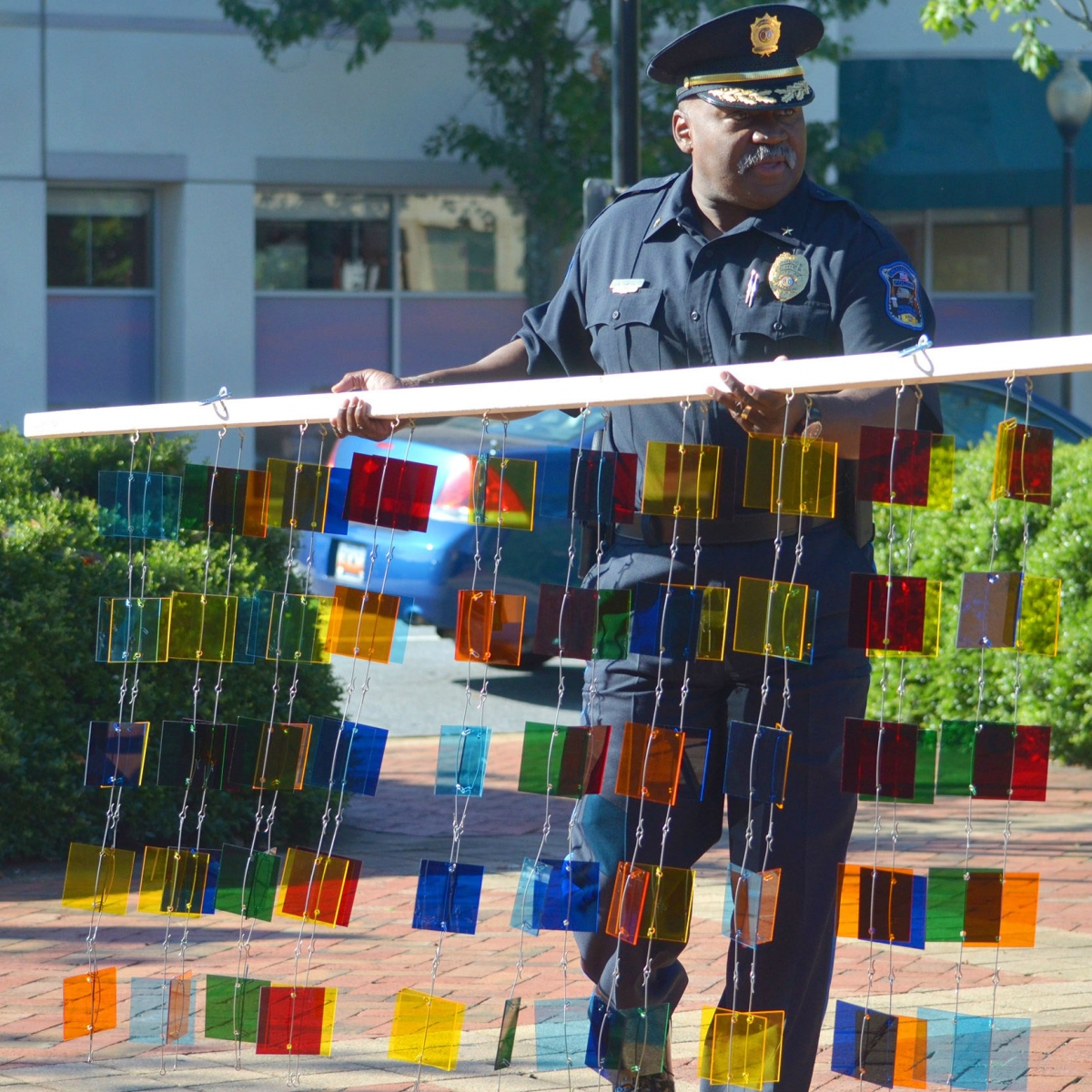 City of Spartanburg, Chief of Police Alonzo Thompson helping to assemble Downtown Mobile Suspension photo taken by Luke Connell, The Palladian Group.