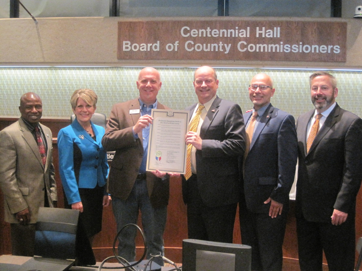 Andy Vick (center left), Executive Director of the Cultural Office of the Pikes Peak Region, with the Board of El Paso County Commissioners, who unanimously approved a Proclamation recognizing October as Arts Month. Photo courtesy of the Cultural Office.