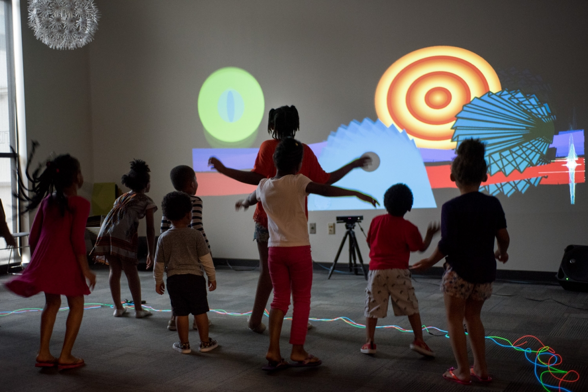 "Participants work together using body movement to create musical composition through the interactive video animation project ""Constellation"" by artist Robbie Lynn Hunsinger. ""Constellation"" was one of eleven public art projects funded through Metro Nashville Arts Commission's Learning Lab Artist Training Program in 2017. Photo by Stacey Irvin."