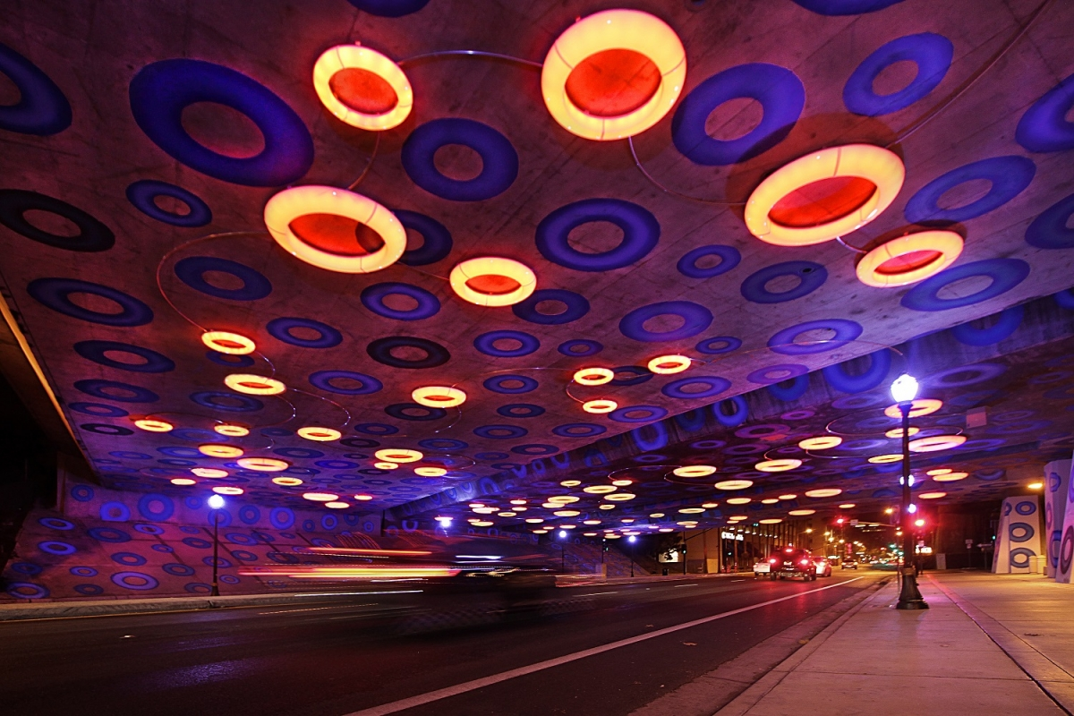 """Sensing YOU"" by Dan Corson in San Jose, CA, was commissioned by San Jose Public Art and San Jose Downtown Association to address an underpass ""considered by most to be a barrier to pedestrian traffic and a danger for cyclists, particularly at night when the lighting was minimal."" Click the photo to learn more."